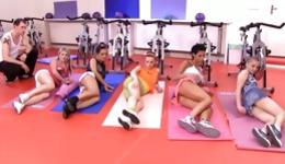 Voluptuous babes doing some stretching in front of shy trainer