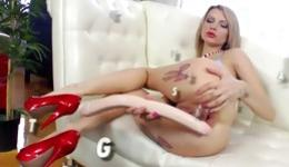 Hot blonde with kinky tattoos getting her both holes slammed deep
