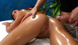 Brunette yummy bitchy woman with nice breasts is getting her massaged