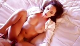 Brunette passionate young whore with large breasts is pressing cock with tits