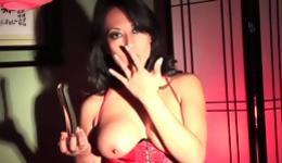 Lovely brunette wearing a slutty corset acting perky sucking a dildo